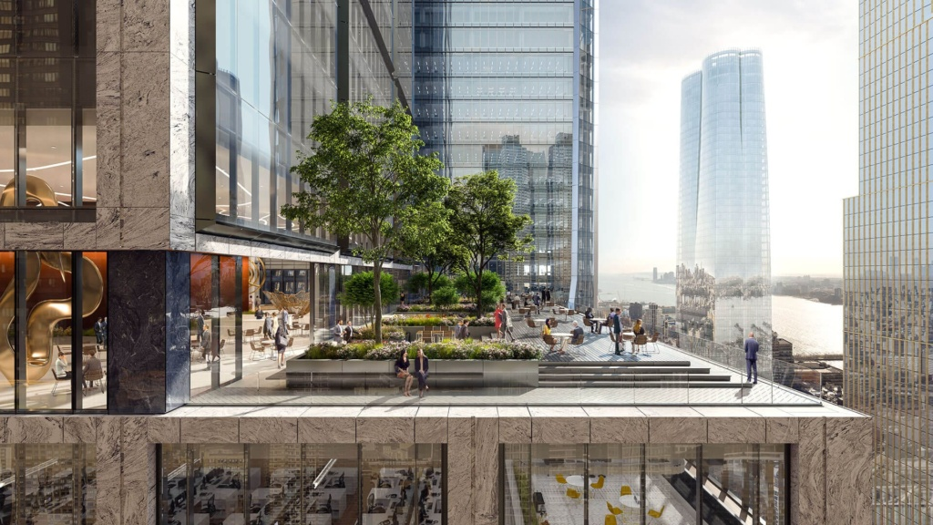 People relax under trees at the landscaped terrace of 50 Hudson Yards.